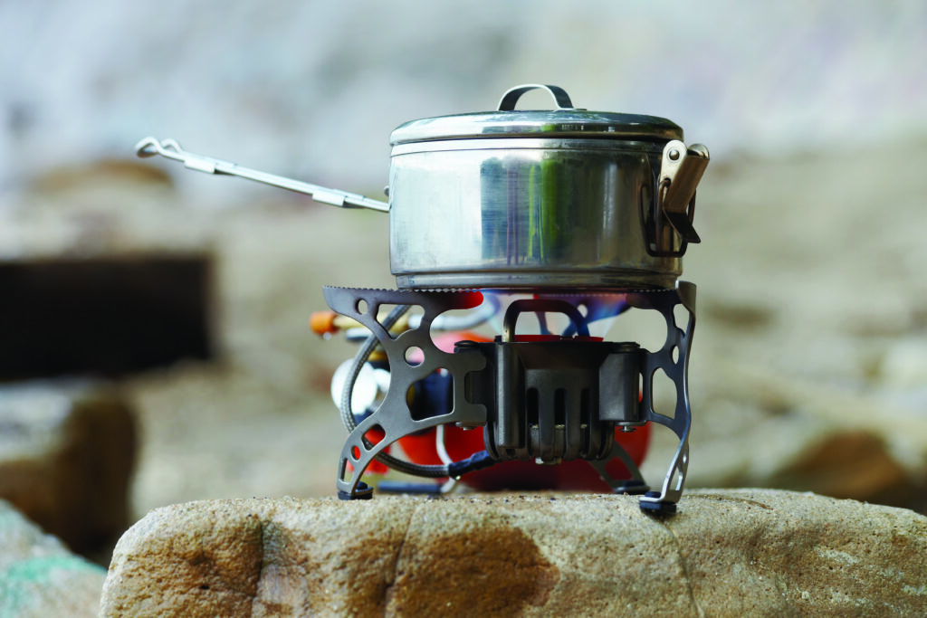 Survival food cooking on a portable gas stove