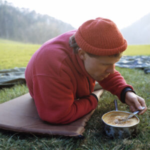Man eating soup he cooked using a survival food recipe