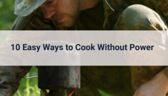 Man outside in camo leaning over portable gas stove