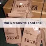 Several MRE emergency food kits spread out on boxes