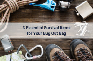 essential survival tools spread out on a wooden floor