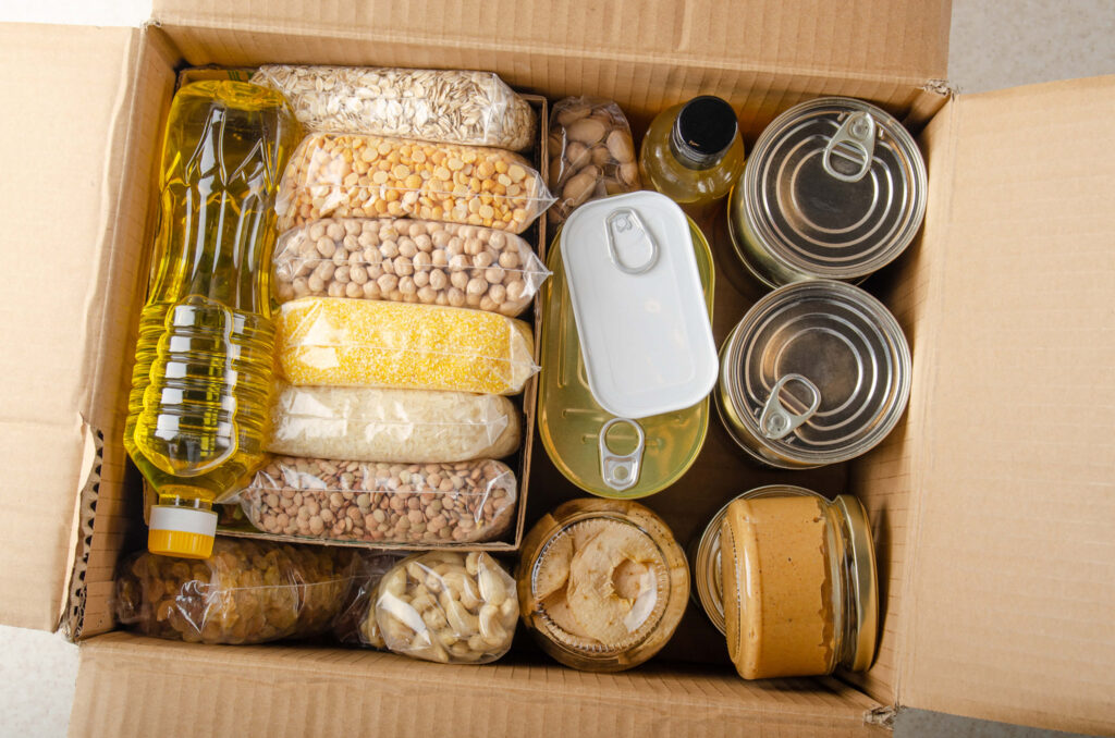 beans, nuts, canned goods and other survival foods in a cardboard box