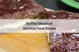 Stuffed Meatloaf survival food recipe sitting on a wooden cutting board